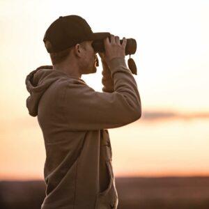 using binoculars to scout deer