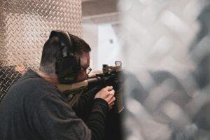 Shooter, aiming down range
