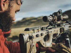 Shooter looking at rifle